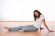 Detalii fotografie Happy teenager sitting on wooden floor