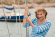 Detalii fotografie Blond young woman on sailing boat