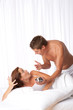 Details der Fotografie Young couple discussing in white bed