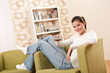 Image details Students - Smiling female teenager watching television