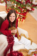 Detalii fotografie Attractive young woman with Christmas decoration