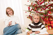 Details der Fotografie Happy blond woman with child on Christmas