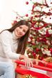 Detalii fotografie Happy woman wrapping Christmas present