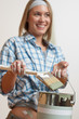 Detalii fotografie Home improvement: Smiling woman holding can and brush