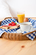 A fényképek részletei Homemade breakfast on wicker tray with checked teacloth