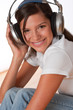 Dettagli della fotografia Smiling teenager with headphones listening to music