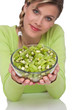 Image details Healthy lifestyle series - Woman holding bowl of kiwi