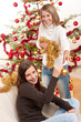 Detalii fotografie Two smiling women with Christmas decoration