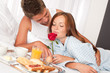 Detalii fotografie Happy man and woman having breakfast in bed together