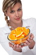 Detalii fotografie Healthy lifestyle series - Woman holding bowl of oranges