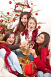 A fényképek részletei Four young woman toasting with champagne on Christmas