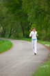Detalii fotografie Jogging - sportive woman running on road in nature
