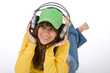Details der Fotografie Happy female teenager enjoy music with headphones