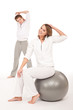 Details der Fotografie Fitness - Healthy couple stretching after training on white