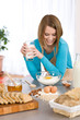 Details der Fotografie Baking - Smiling woman with healthy ingredients