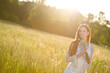 Image details Long red hair woman in romantic sunset meadow