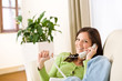 Detalii fotografie On the phone home: Smiling woman calling in lounge