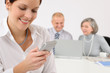 Image details Young executive woman use phone during meeting