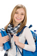 Image details Student teenager woman with schoolbag hold books