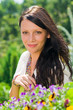 Details der Fotografie Summer garden beautiful woman smiling flower
