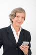 Detalii fotografie Senior businesswoman smile hold cellphone