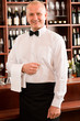 Detalii fotografie Wine bar waiter mature smiling in restaurant