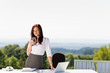 Detalii fotografie Young businesswoman in sunny nature office table