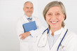 Details der Fotografie Medical doctor team seniors smiling hold folders