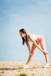 Detalii fotografie Summer sport fit woman stretching on beach