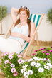 Detalii fotografie Summer terrace red hair woman relax in deckchair