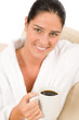 Detalii fotografie Attractive woman in white bathrobe with coffee