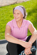 Image details Senior sportive woman sitting on mat sunny