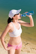 Detalii fotografie Summer sport fit woman drink water bottle
