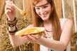 Image details Redhead hippie woman have breakfast in barn
