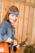 Image details Young country woman playing guitar in barn
