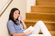 Detalii fotografie Home living woman call phone sitting staircase