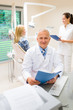 Detalii fotografie Mature dentist surgeon at dental clinic patient