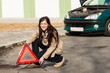Details der Fotografie Woman putting warning triangle on the road