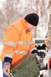 Detalii fotografie Man filling woman car gas winter assistance