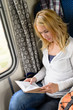 Detalii fotografie Woman traveling by train and reading book