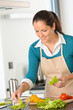 Detalii fotografie Smiling woman making salad vegetables kitchen preparing
