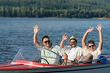 Detalii fotografie Cheerful young guys partying in speed boat