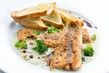 Detalii fotografie lightly fried salmon with herb sauce with broccoli and baked baguettes