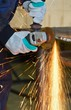 Detalii fotografie yellow hot sparks at grinding steel material