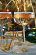 Detalii fotografie fluted champagne glasses and ribbons on gold background