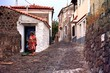 Detalii fotografie Summer. Ostrov, street, town houses and Molyvos. Greece - Lesbos.
