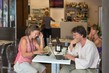 Detalii fotografie cortona italy  july 1 people after lunch sitting in a cafe and relax while working on laptop july 1 2014