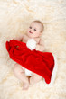 Dettagli della fotografia lying child girl with red christmas santa hat