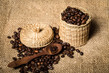 Dettagli della fotografia pile of coffee beans and wooden spoon in jar with space for text