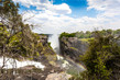 Detalii fotografie the victoria falls is the largest curtain of water in the world 1708 meters wide the falls and the surrounding area is the national parks and world heritage site  zambia zimbabwe